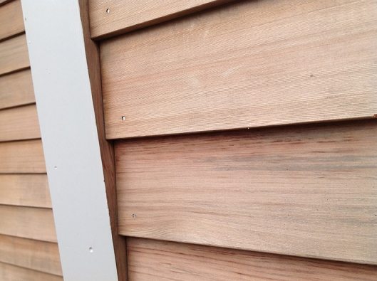 A photo supplied to the Amish builder showing the overlapping siding detail I desire.