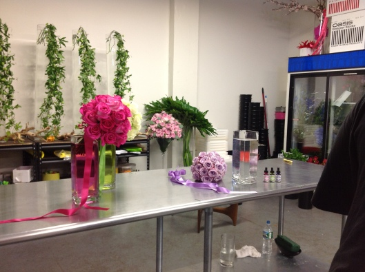 The completed floral arrangements highlighted by the creative touch of colored water